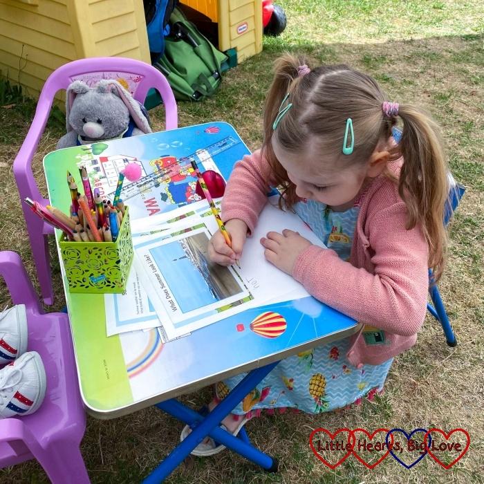 Sophjie doing home-schooling in the garden