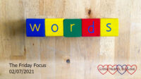 The word 'words' spelled out in colourful wooden blocks
