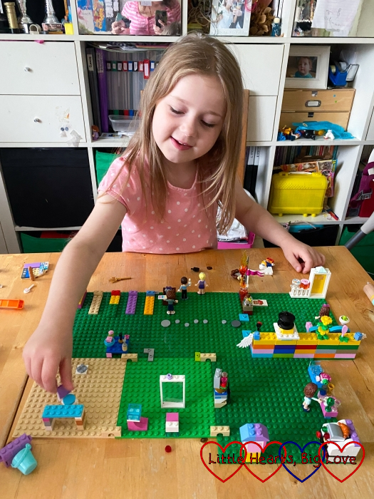 Sophie playing with Lego