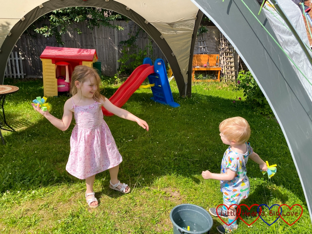 Sophie and Thomas throwing waterbomb sponges at each other