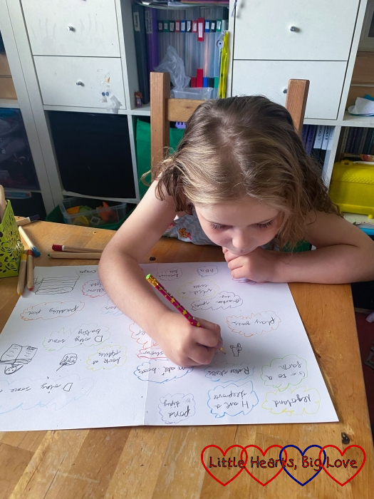 Sophie writing down her summer activities list