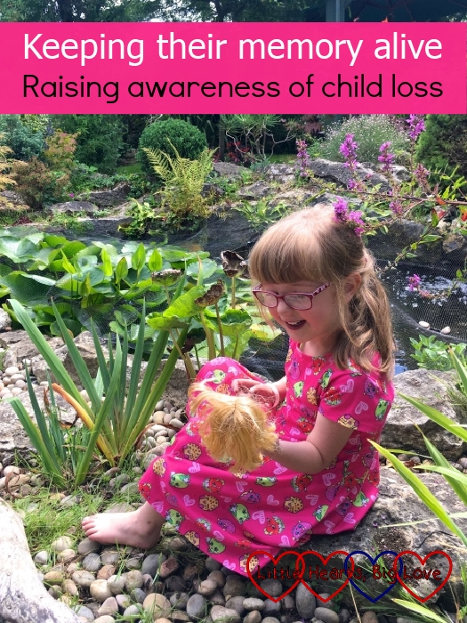 """Jessica sitting next to a pond looking at a doll she is holding - """"Keeping their memory alive – raising awareness of child loss"""""""