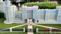 """A Lego model of Windsor Castle with the England men's football team in front and a banner saying """"Well done England"""""""