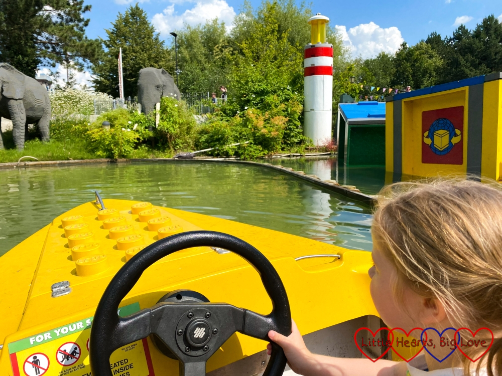 Sophie driving a yellow LEGO boat