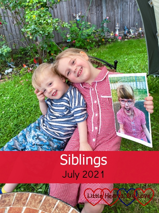 """Sophie and Thomas sitting together on the same chair in the garden with Sophie holding a photo of Jessica - """"Siblings - July 2021"""""""