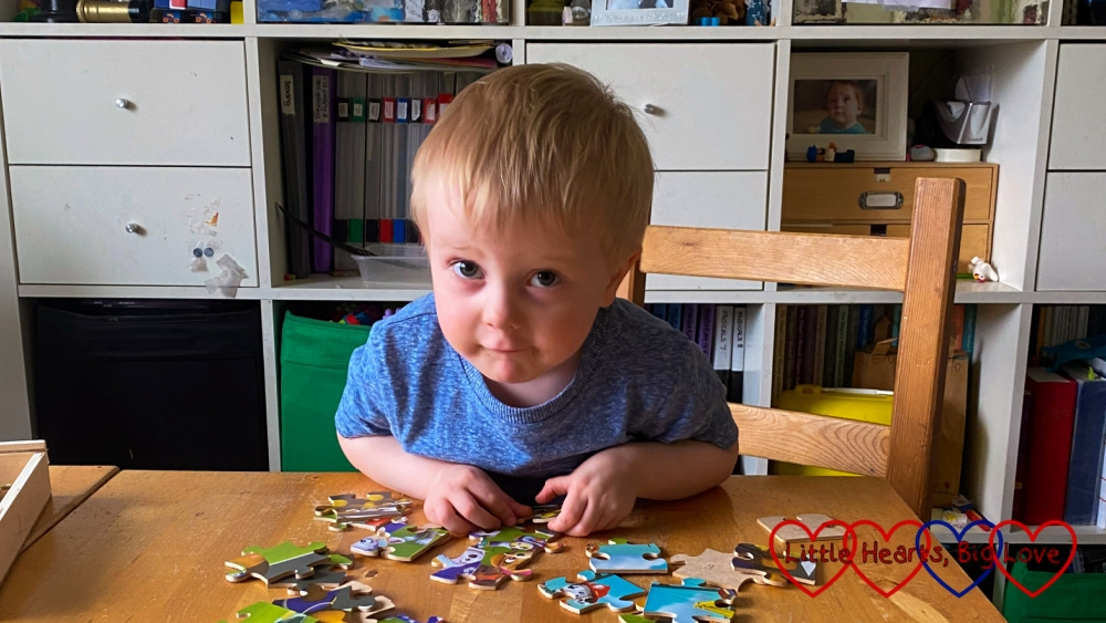 Thomas at the table with a jigsaw puzzle
