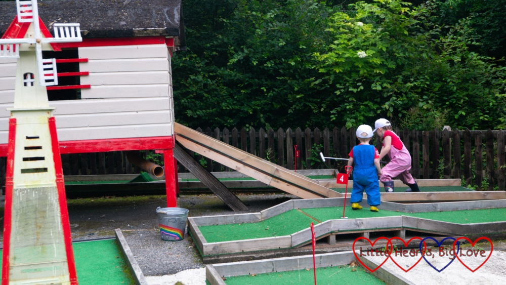 Sophie and Thomas playing on the crazy golf at Coombe Mill