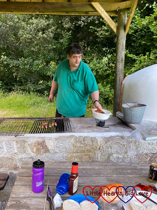 Hubby using one of the outdoor barbecue areas at Coombe Mill