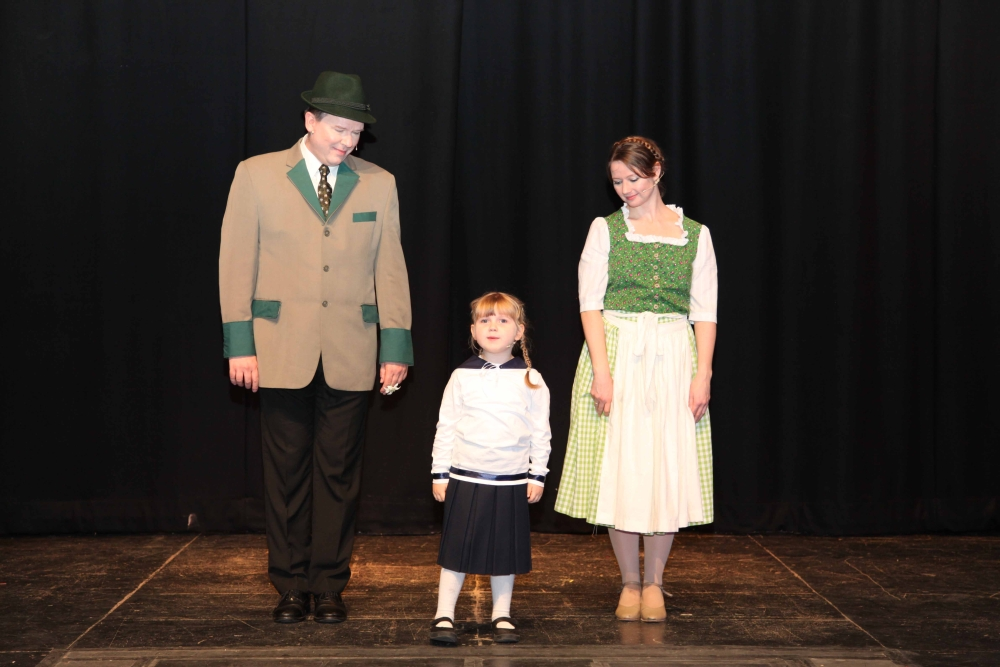 Sophie playing Gretl with Captain von Trapp and Maria in The Sound of Music
