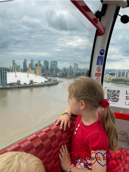Sophie looking out of the window at the O2 on the Emirates Air Line