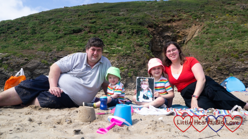 Hubby, Thomas and Sophie (in matching rainbow striped tops, with Sophie holding a photo of Jessica) and me on the beach at Baby Bay