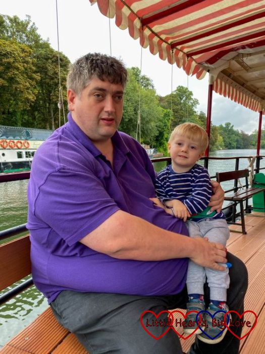 Hubby and Thomas on a paddleboat on the Thames