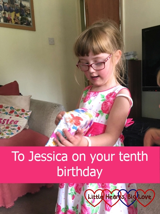 """Jessica on her 6th birthday opening one of her birthday presents - """"To Jessica on your tenth birthday"""""""