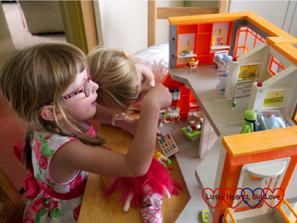 Jessica and Sophie playing with Jessica's Playmobil hospital on Jessica's 6th birthday