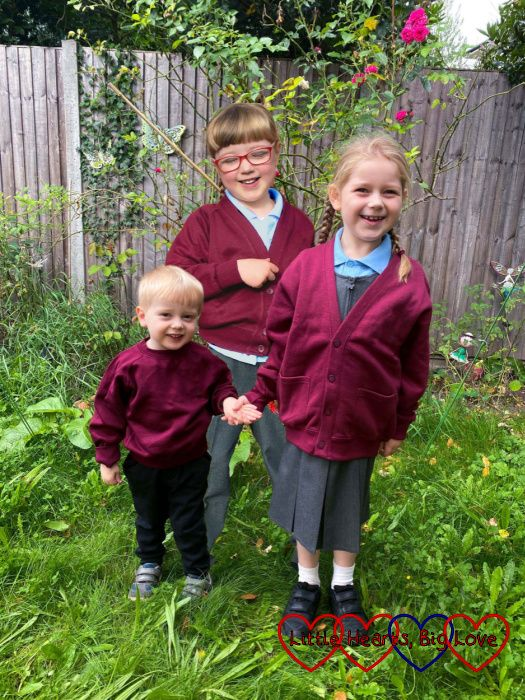 Sophie and Thomas in the garden in their school uniform with Jessica in her school uniform photoshopped behind them