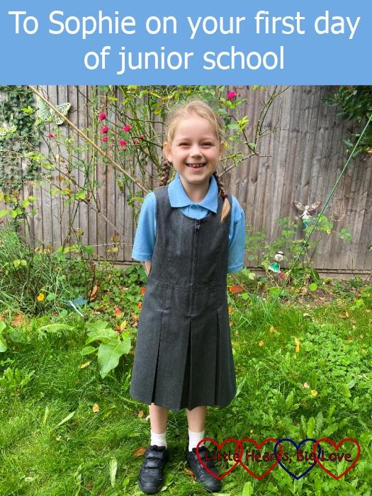"Sophie standing in her school uniform in the garden - ""To Sophie on her first day of junior school"""
