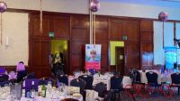 Jessica's banner in the background of tables and chairs set up for the Dine with Davina event