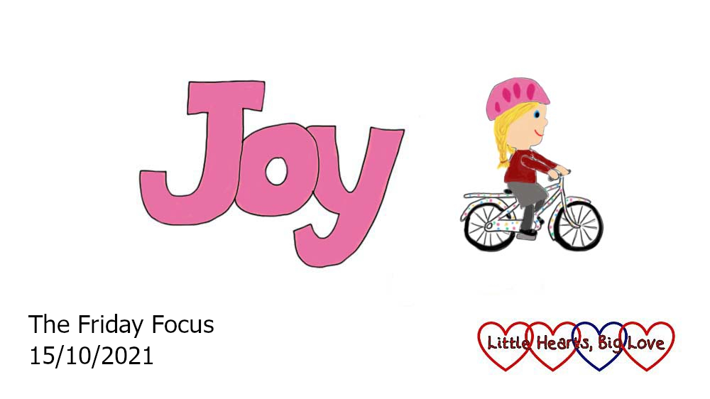The word 'joy' in pink with a drawing of Sophie riding her bike